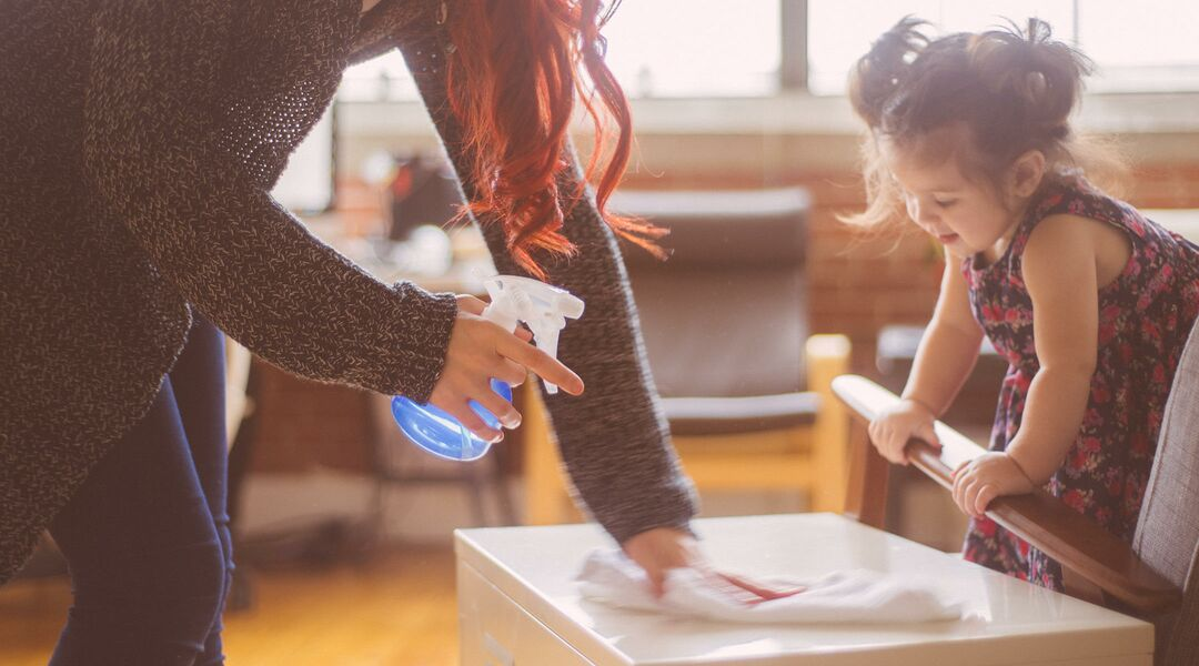 mom and toddler daughter doing chores around the house