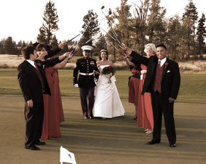 Bride and Groom coming through Golf Club Arch, so Groom could make a