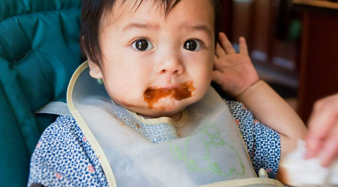 baby eating and making a mess