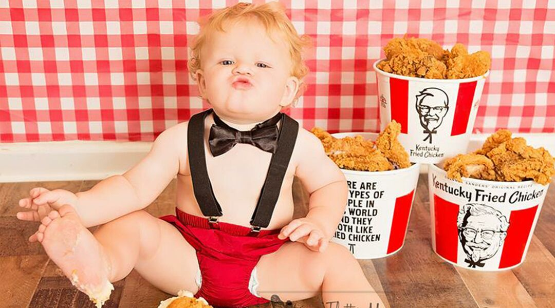 Baby posing with KFC fried chicken and mashed potato cake