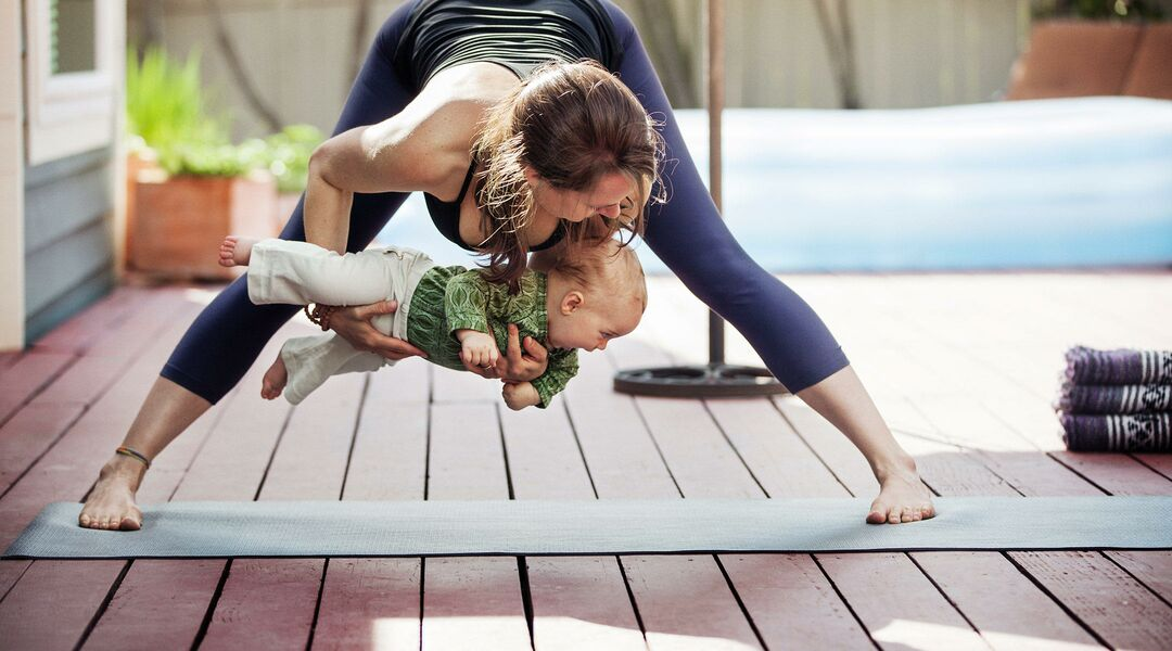 mom doing fitness holding her baby