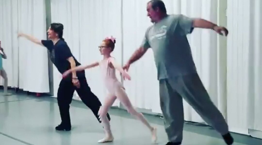 Dad mimicking daughter's ballet move