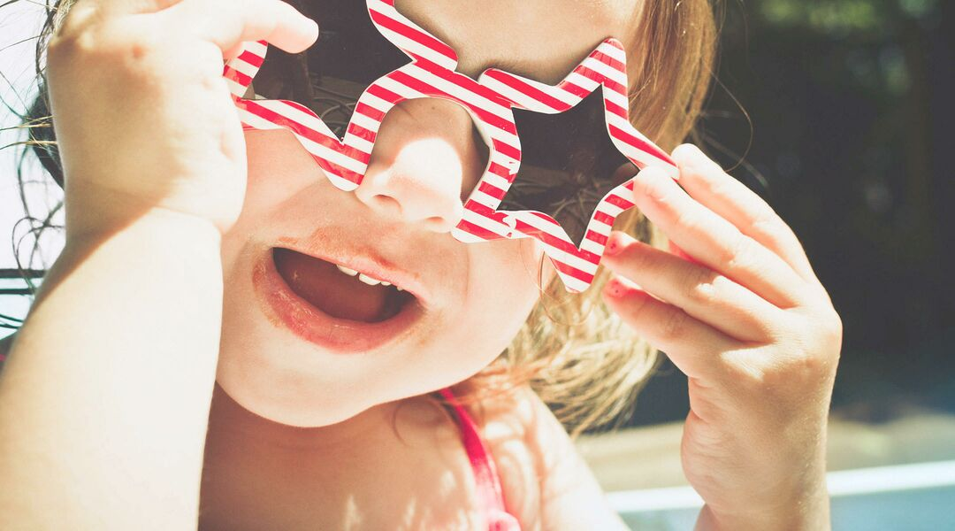 baby celebrate fourth of july with festive sunglasses