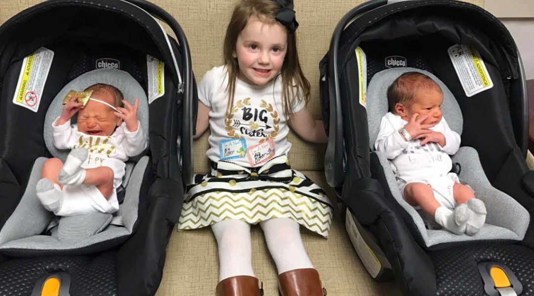 Big sister with new twin siblings