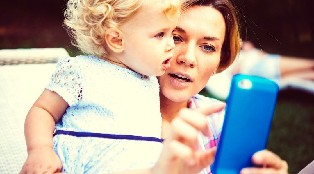 Woman and toddler girl on cellphone