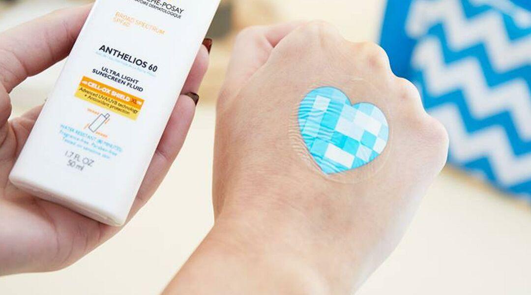 UV patch -- blue heart sticker on hand