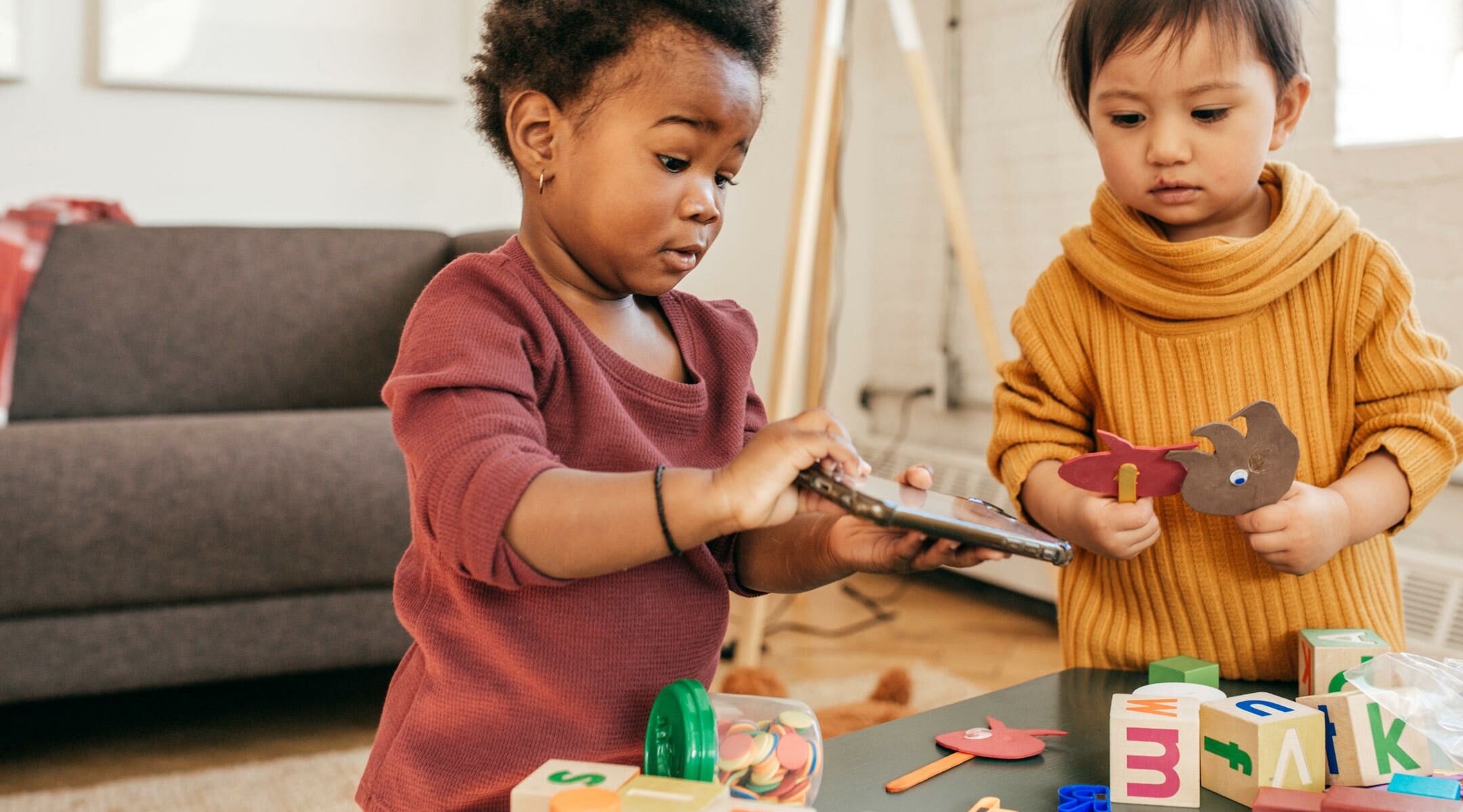 two toddlers demonstrating parallel play