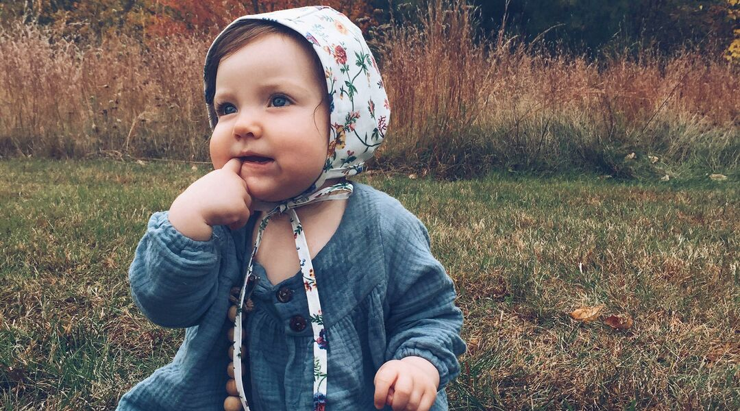 Baby in Bonnet in Field