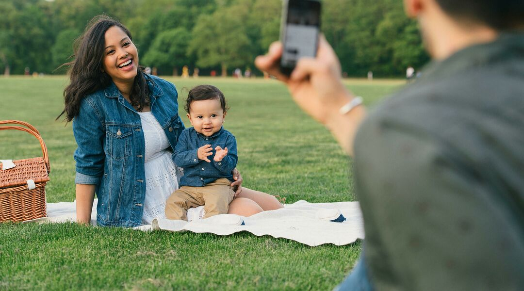 Baby model and happy family in park