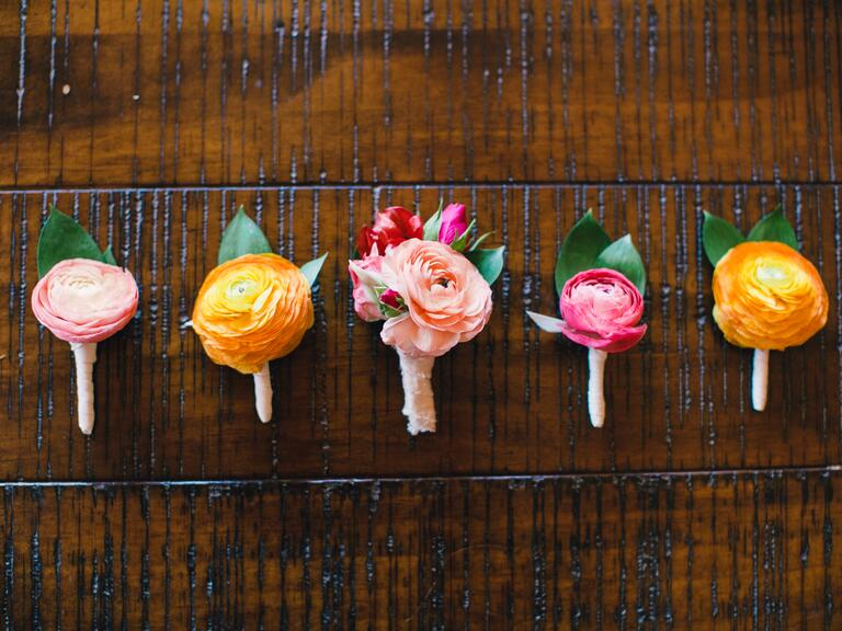 Pink and yellow ranunculus boutonnieres