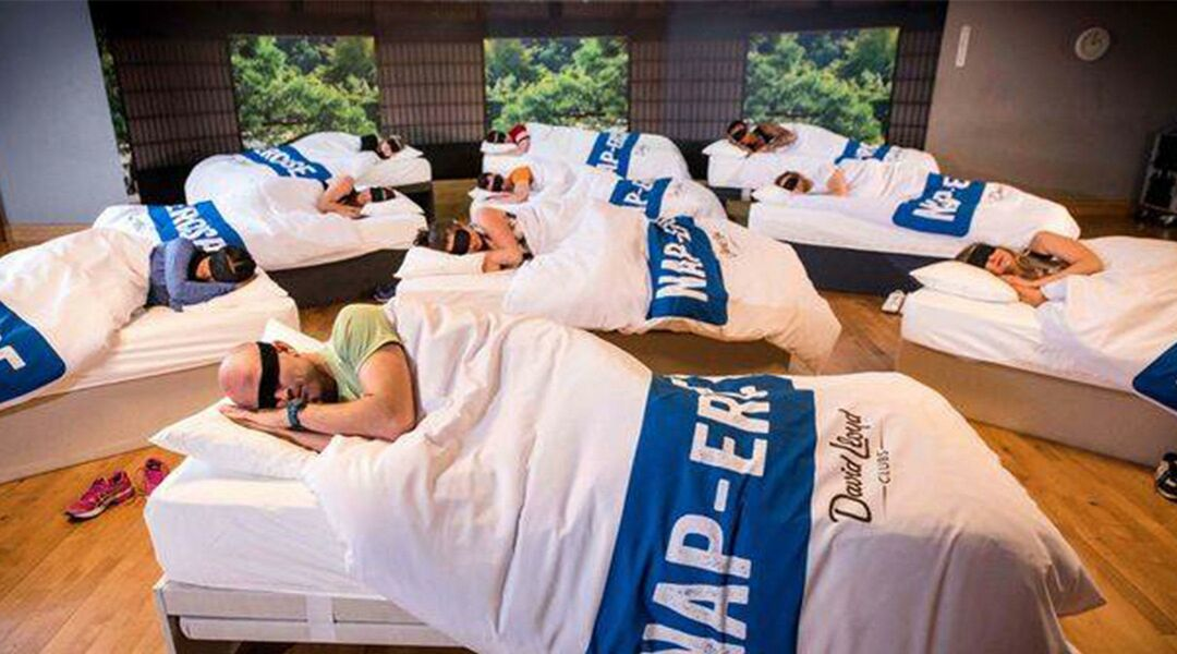 adults  sleey parents napping in beds during group exercise class