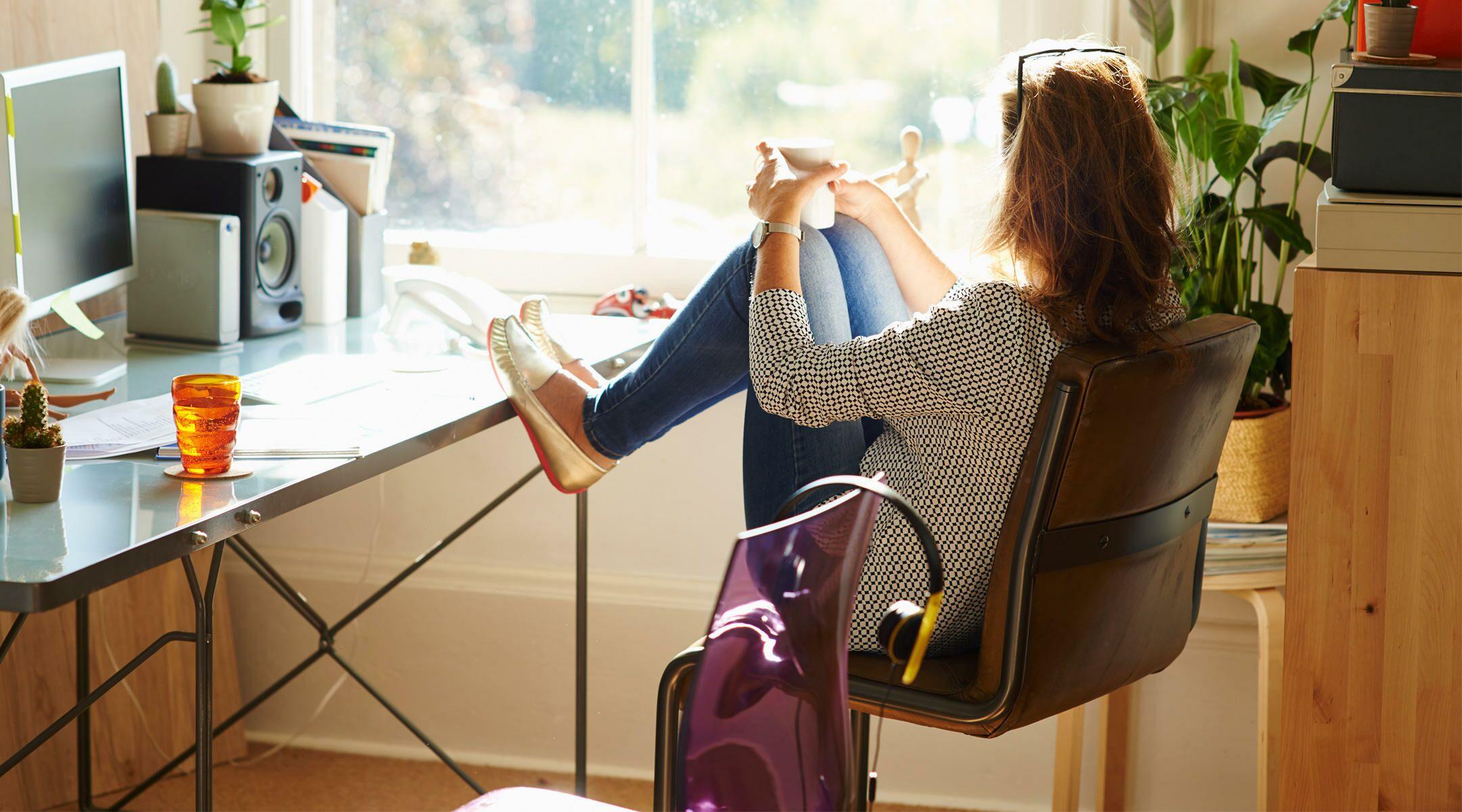 woman sitting looking through sunny window