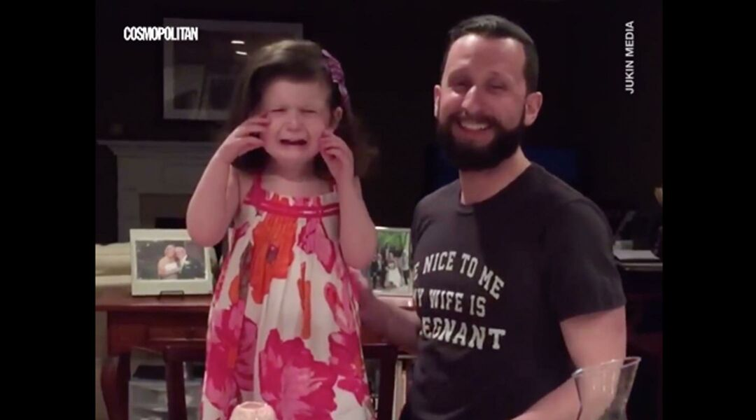 Little girl crying next to dad