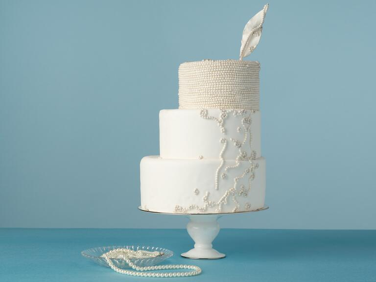 Staircase wedding cake with deco design