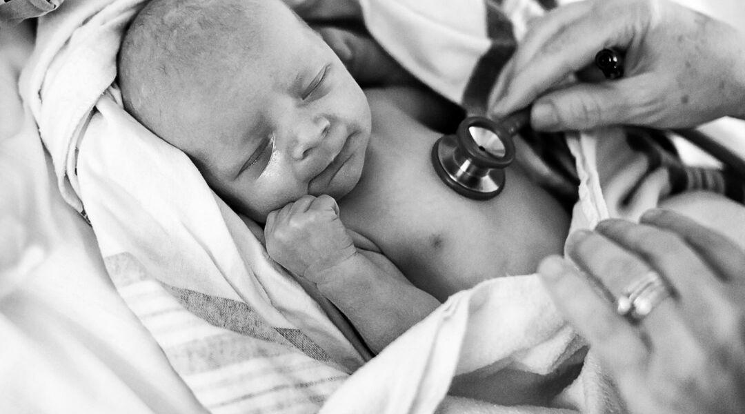 birth newborn baby taking care of nurse