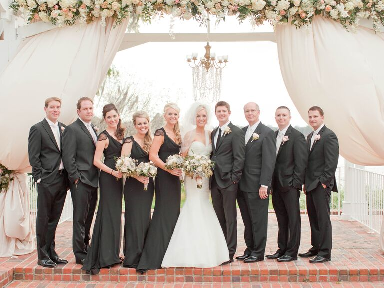 Uneven Number Of Bridesmaids And Groomsmen All Wearing Black