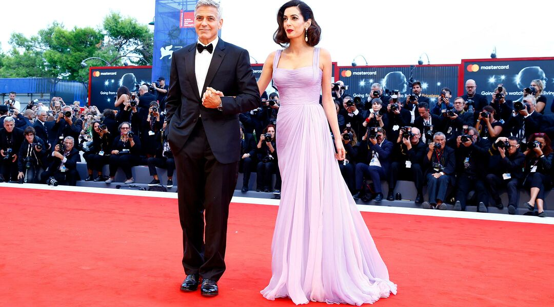 celebrity couple george and amal clooney on the red carpet