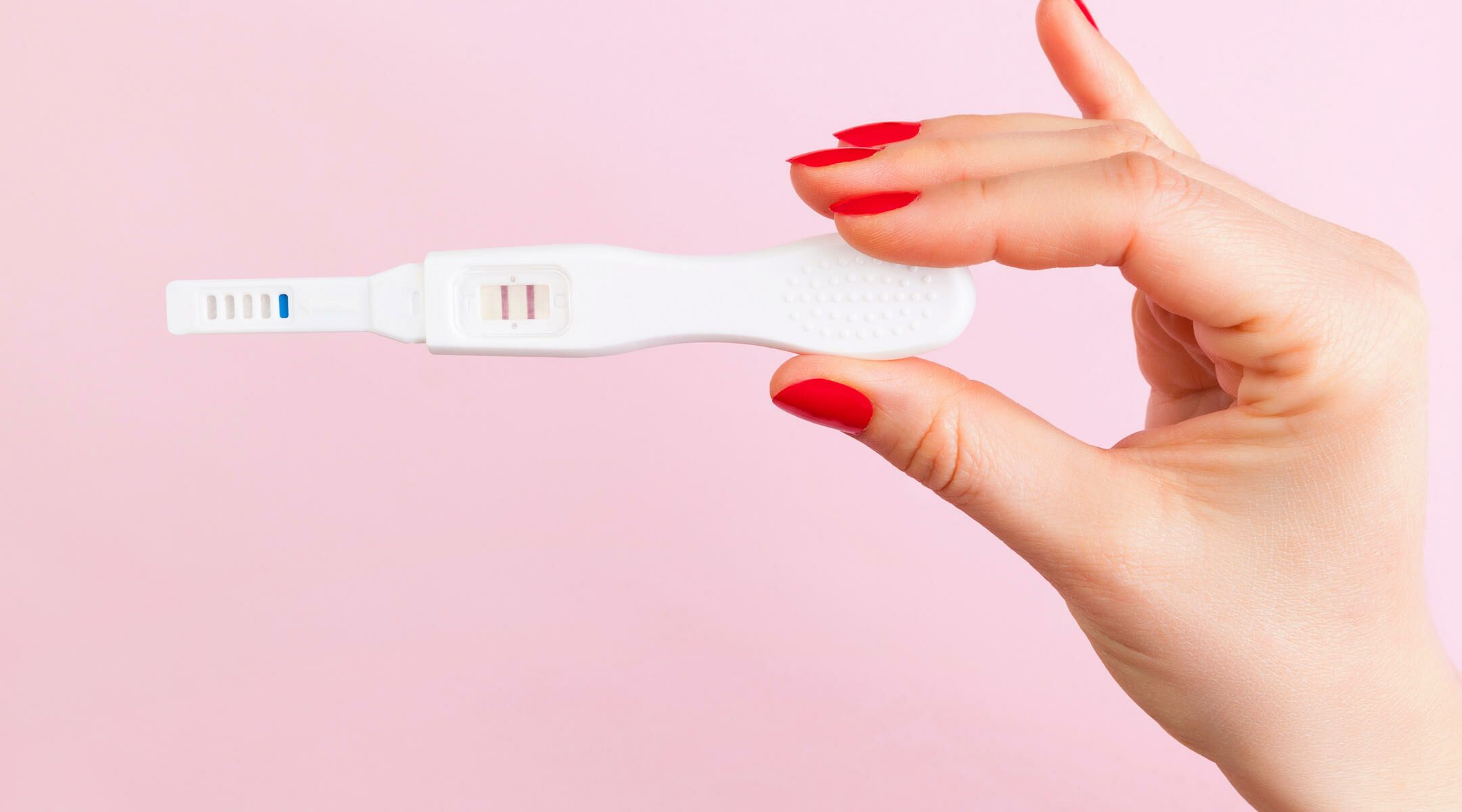 home pregnancy test in hand