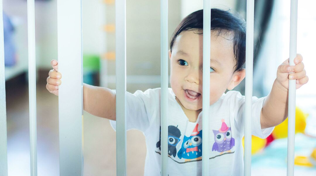 Baby behind baby gate