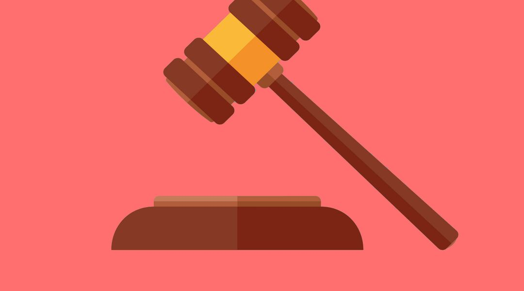 Cartoon image of gavel with teal background