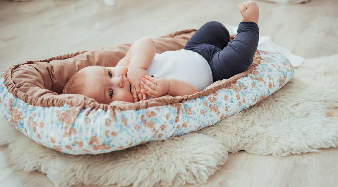 Baby in a sleep positioner