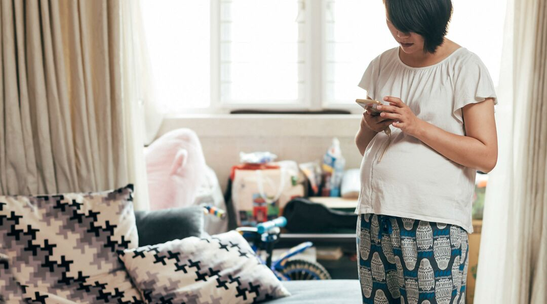 pregnant woman at home on phone