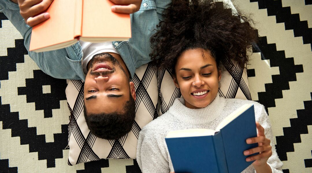 Couple reading parenting books