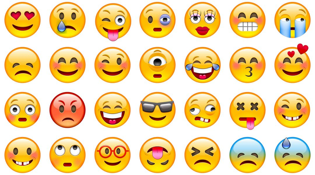A collage of various emojis with different expressions