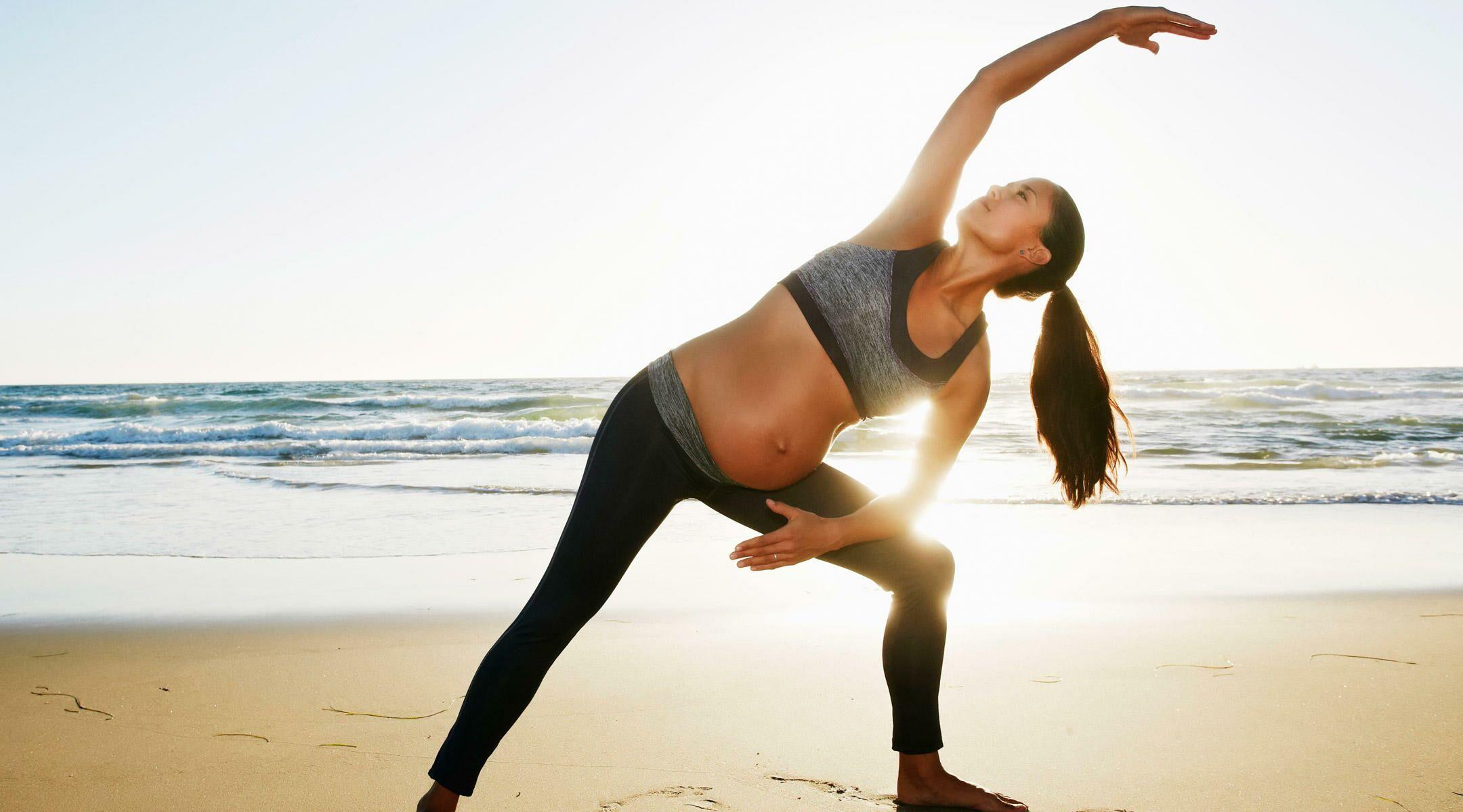 pregnant woman exercise beach