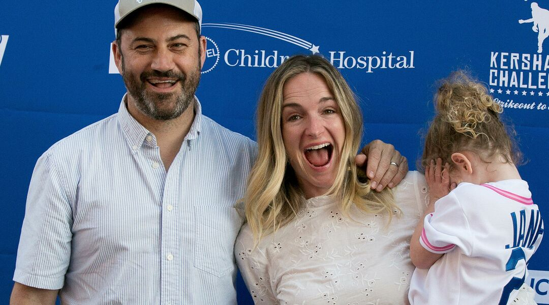 Molly McNearney holding daughter next to husband Jimmy Kimmel
