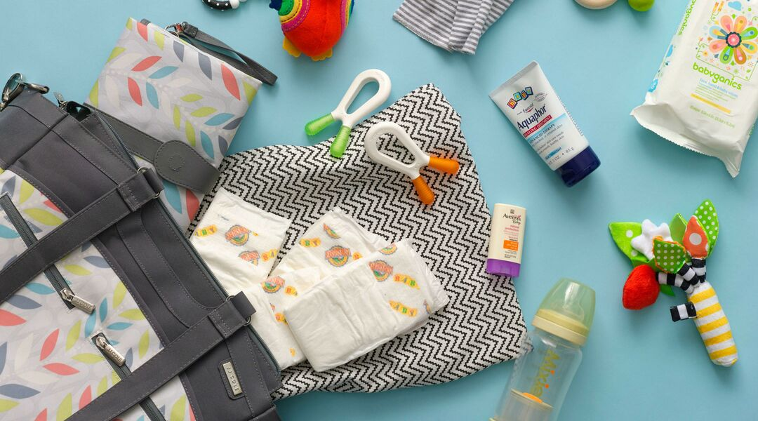 Diaper bag with contents spilling out.