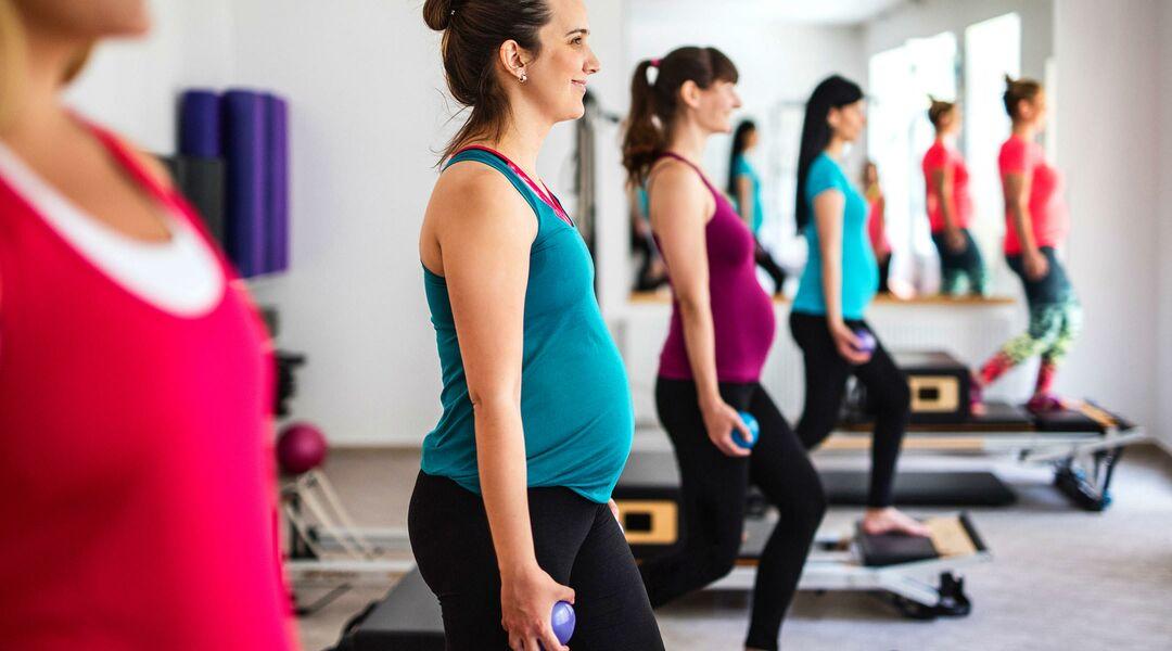 pregnant women fitness class pilates