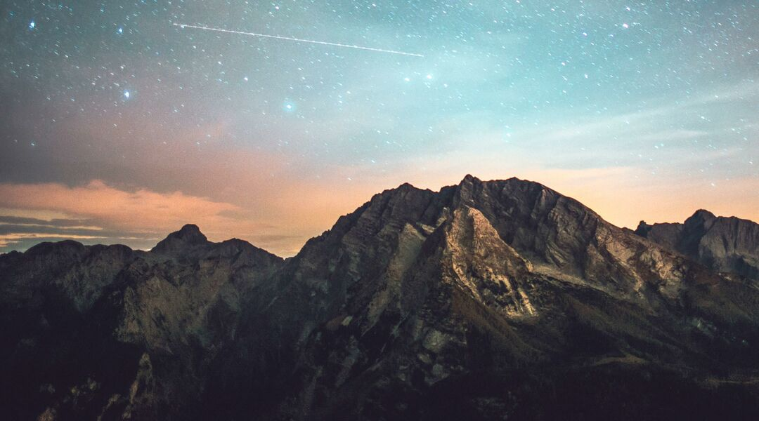 Beautiful starry night sky with mountains.
