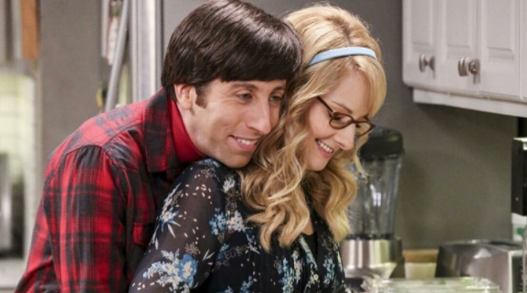 Bernadette and Howard embracing and cooking on The Big Bang Theory