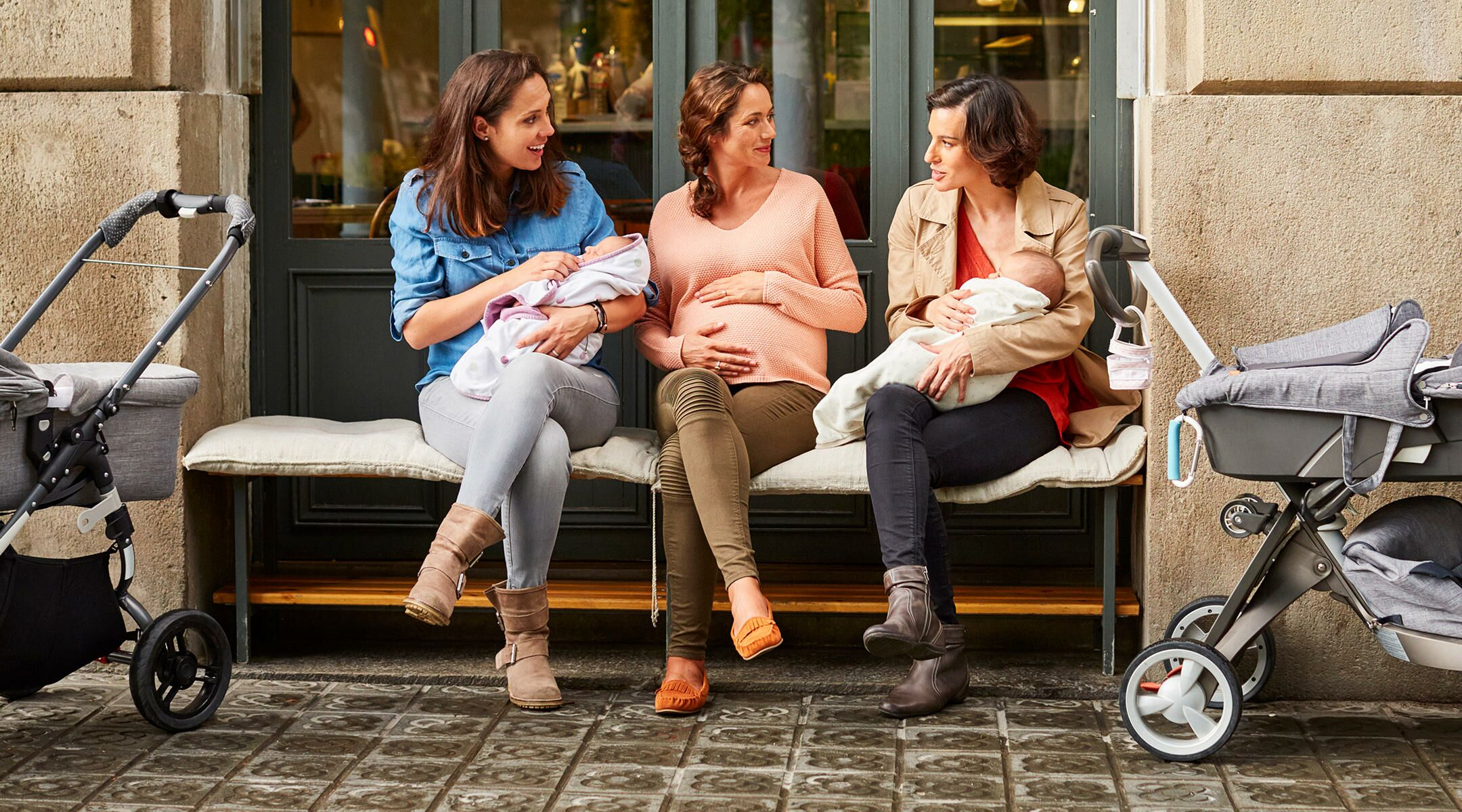 Three mom friends sitting outside