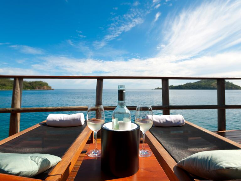 Wine cruise with chaise lounges over looking the water