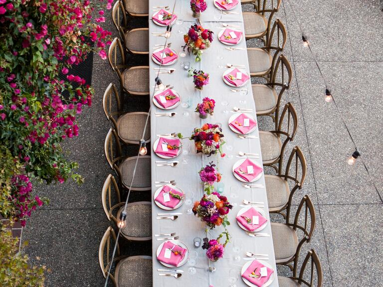 An aerial view of a reception with pink accents