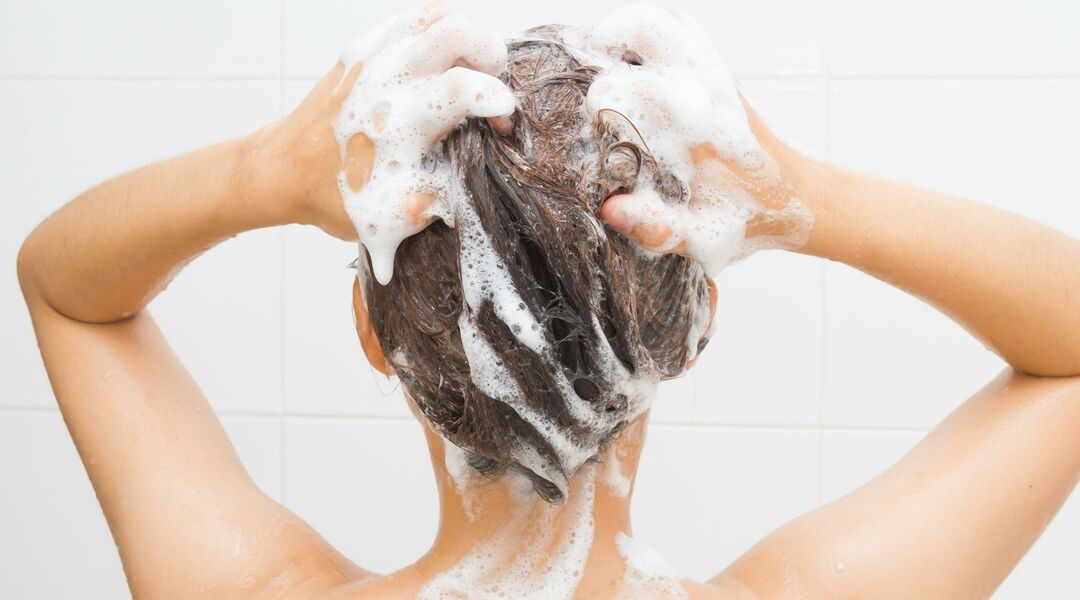 woman shampooing