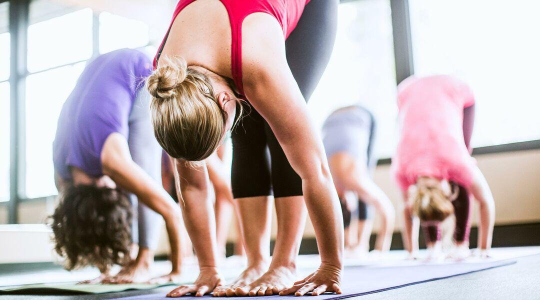 Woman bending over doing yoga