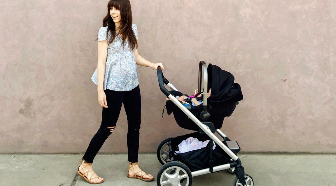 new mom pushing baby in stroller