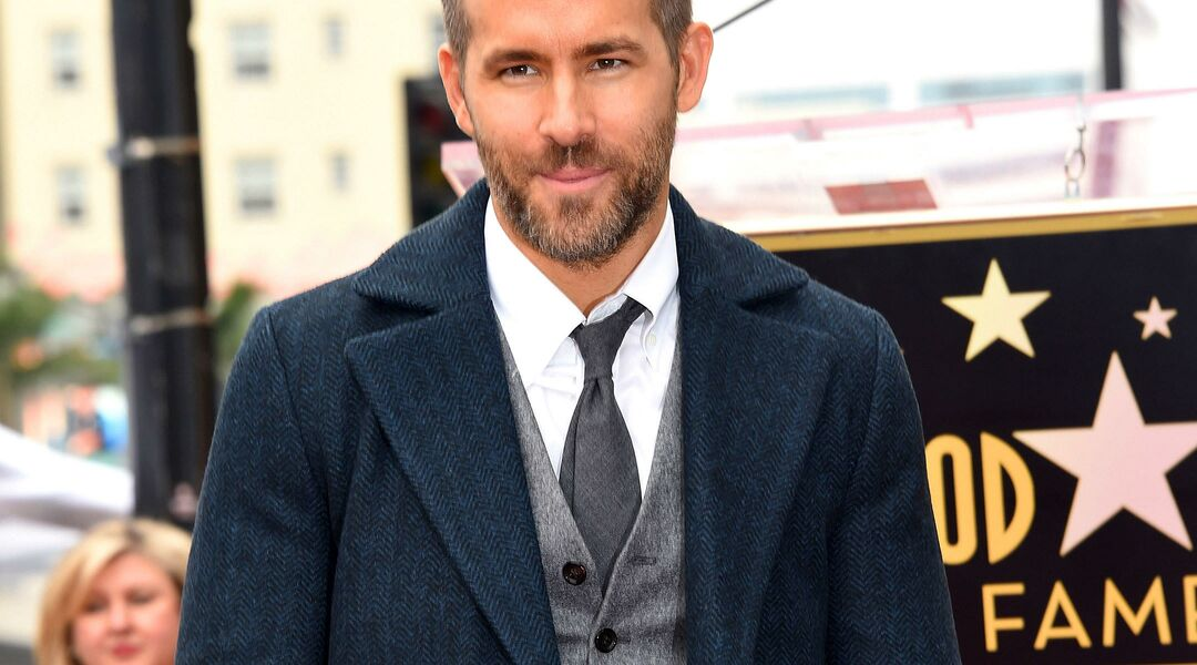 Ryan Reynolds arm in arm with Blake Lively