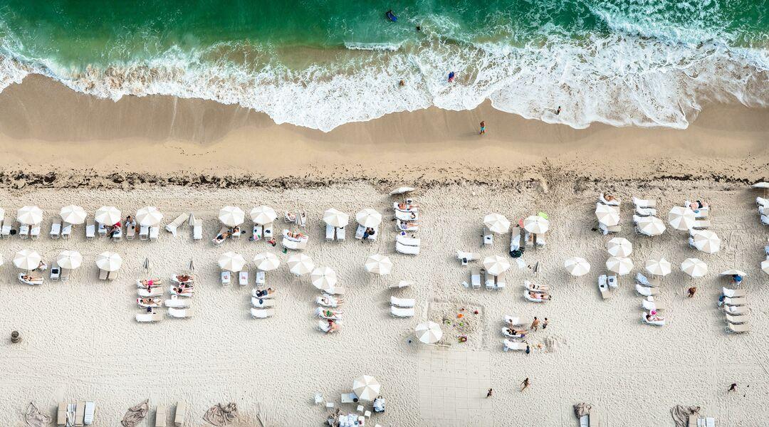 beach scene people ocean umbrellas