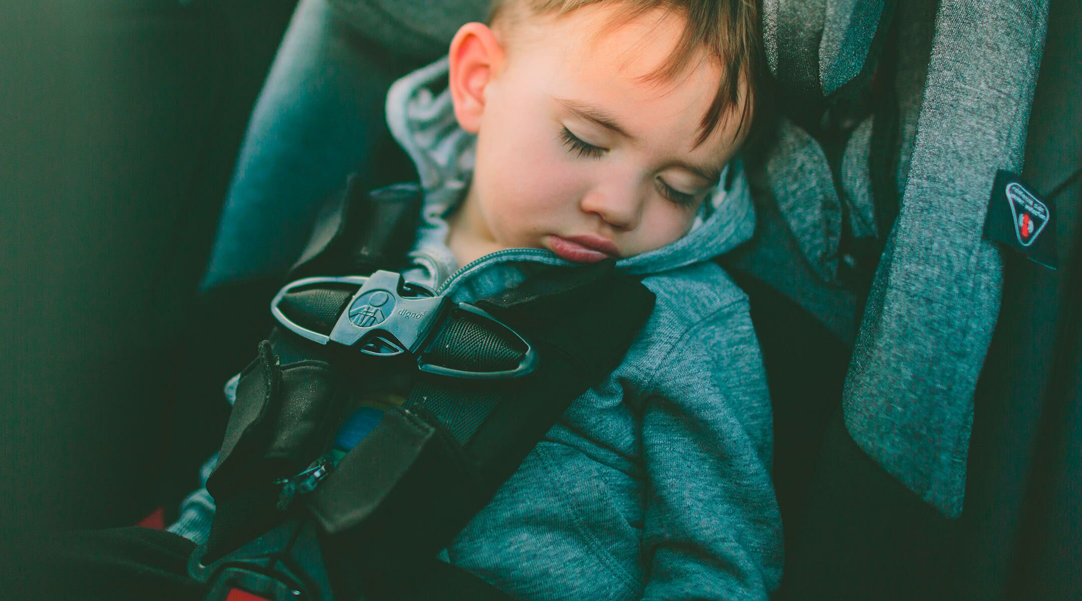 Toddler Boy Asleep In Car Seat