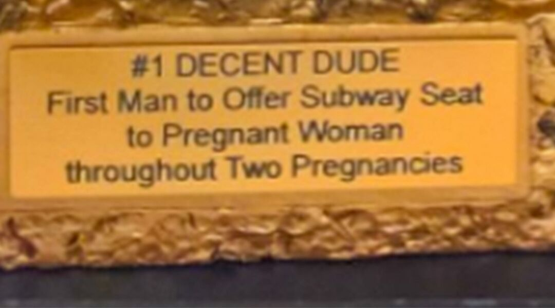 pregnant woman gives actual trophy to man who gave up his