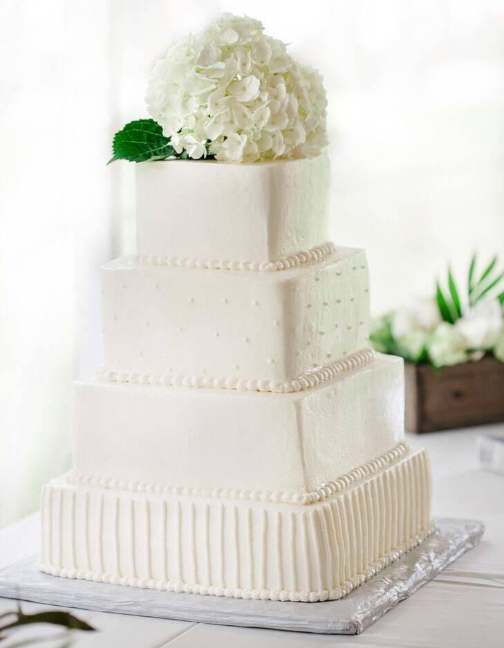 White square wedding cake with hydrangea topper