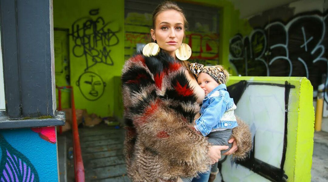 woman breastfeeding with graffiti background