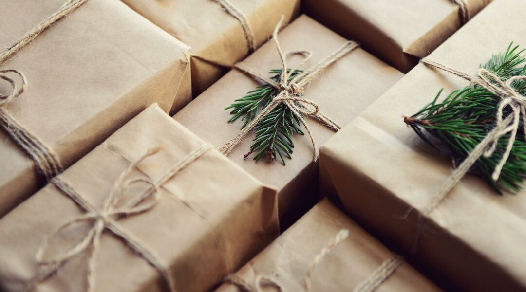 Gifts beautifully wrapped in brown paper.