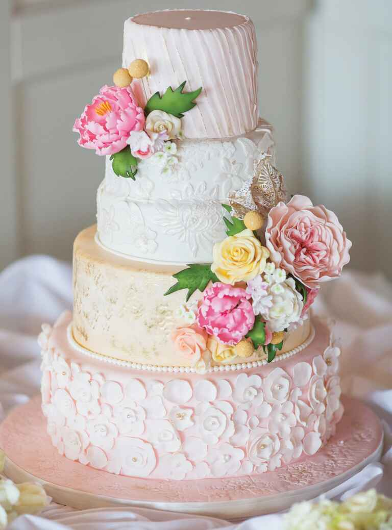 Pink, yellow and white wedding cake with sugar flowers