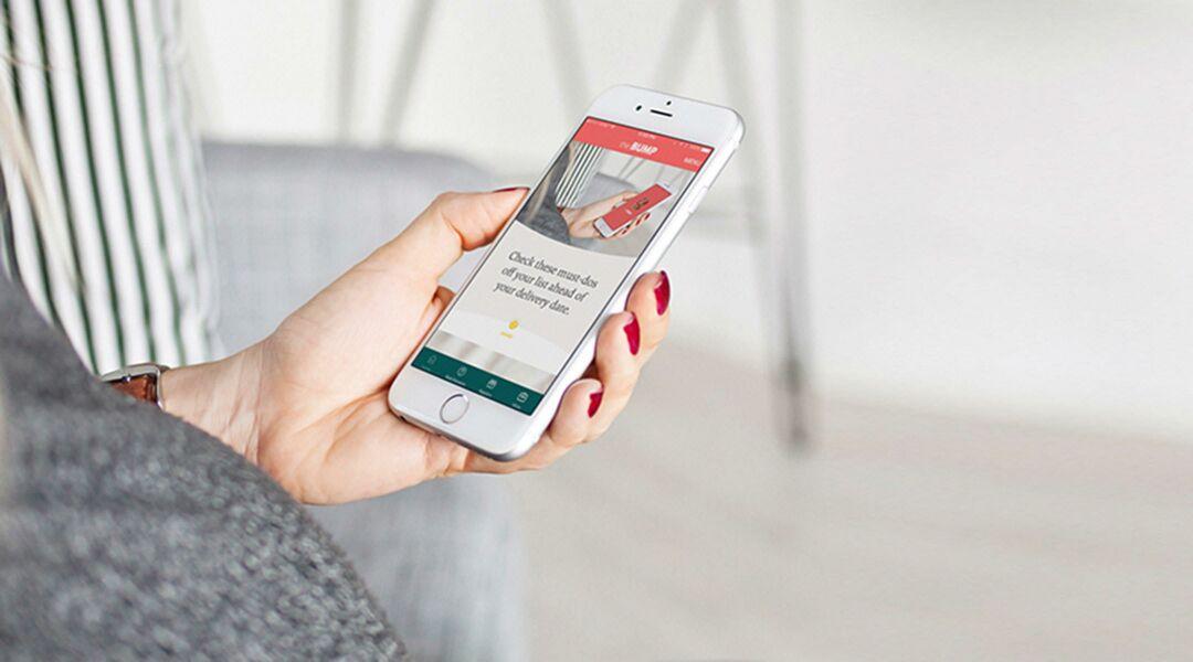 pregnant woman on bump app mobile phone