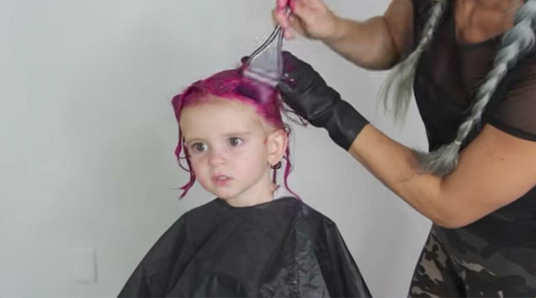 Toddler having her hair dyed pink